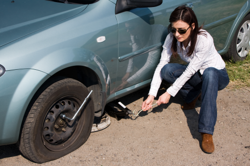 how to change a flat tire on a busy road Periodically check to make sure that your spare tire is not flat how to replace a flat tire make changing a tire on the side of a busy road a little.